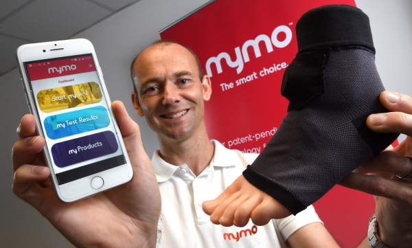 CPI has helped Craig Downs take mymo forward. Mr Downs is pictured with a wearable sock that uses artificial intelligence to monitor a runner's gait before sending the information to a smartphone