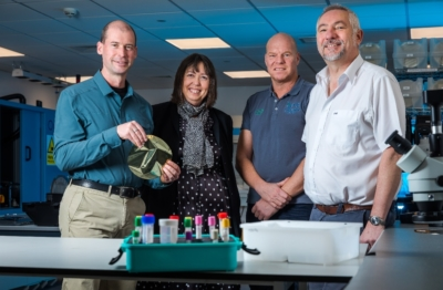 NETPark businesses Quality Hospital Solutions (QHS) and PragmatIC, work together on SamplePod. L/R: - Scott White (CEO PragmatIC), Janet Todd (NETPark manager at Business Durham), Andrew Turner (MD of QHS and inventor of SamplePod), Ken Williamson (Chief Opertaions Office, PragmatIC)